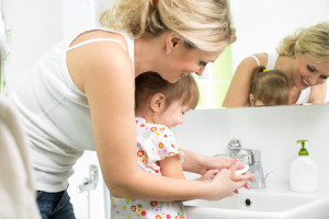 25719766 - mother washing baby hands